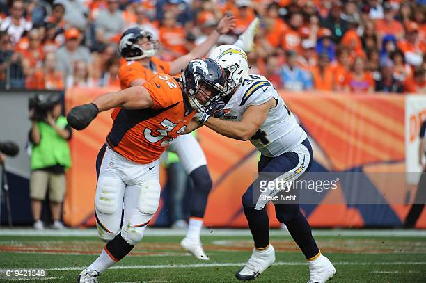 Denver Broncos fullback Andy Janovich fights to get into punt coverage against the San Diego Chargers at Sports Authority Field at Mile High on...