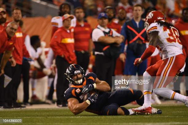 Denver Broncos fullback Andy Janovich makes a diving pass for a first down in the fourth quarter as the Denver Broncos played the Kansas City Chiefs...