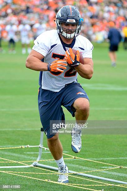 Denver Broncos fullback Andy Janovich runs a drill during practice at training camp on August 2016 in Dove Valley