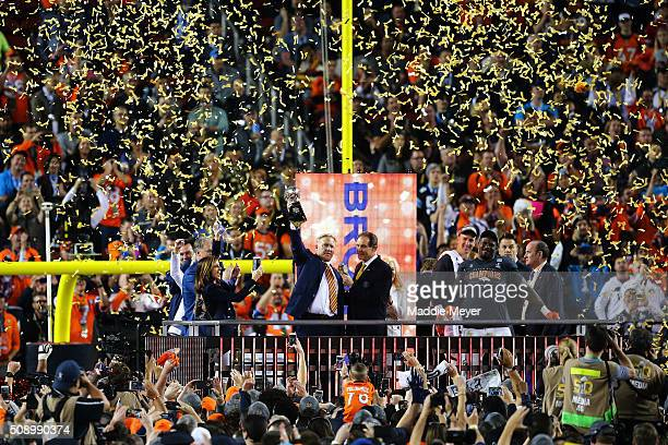 Denver Broncos general manager John Elway holds up the Vince Lombardi Trophy after defeating the Carolina Panthers during Super Bowl 50 at Levi's...