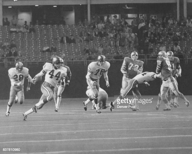 Denver Broncos Halfback Floyd Little speeds past a group of Houston defenders en route to his thirdquarter touchdown during Denver's 3817 setback...