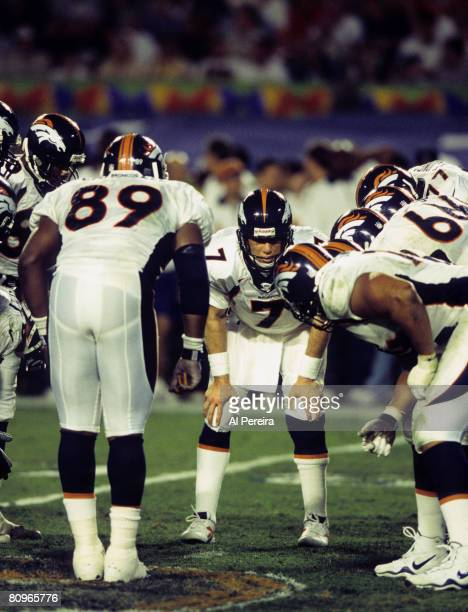 Denver Broncos Hall of Fame quarterback John Elway calls the play in the huddle during Super Bowl XXXIII a 3419 Denver Broncos victory over the...