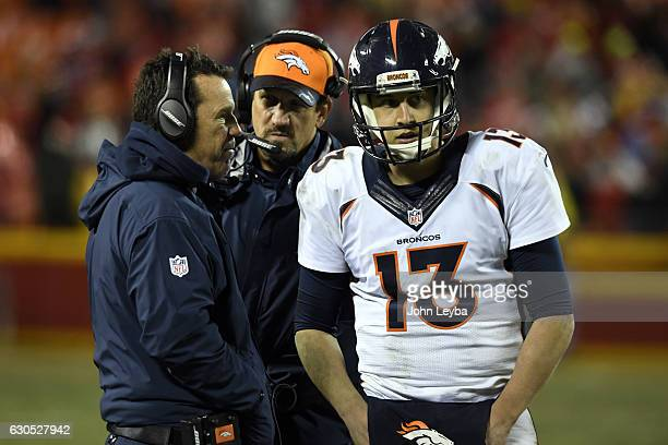 DECEMBER 25 Denver Broncos head coach Gary Kubiak talks with Denver Broncos quarterback Trevor Siemian with second left in the game during their loss...