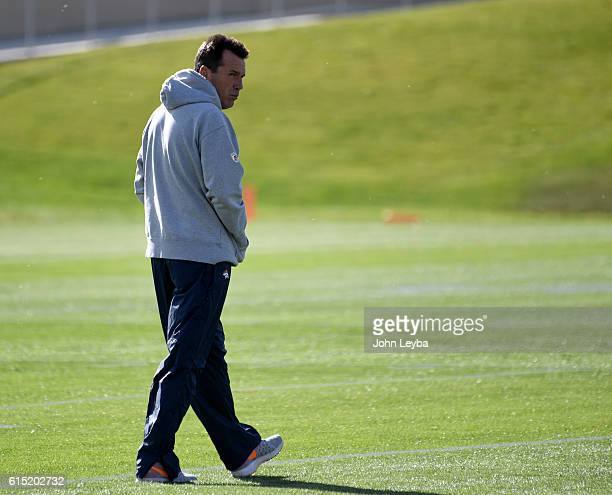Denver Broncos head coach Gary Kubiak walks the field during practice October 17 2016 at Dove Valley
