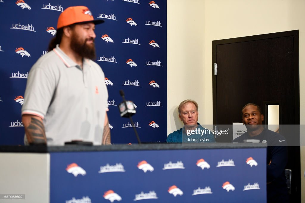 Denver Broncos head coach Vance Joseph and Denver Broncos executive vice president of football operations and general manager John Elway listen to Denver Broncos nose tackle Domata Peko on March 13, 2017 in Denver, Colorado at Dove Valley. Peko addressed the media during a press conference.