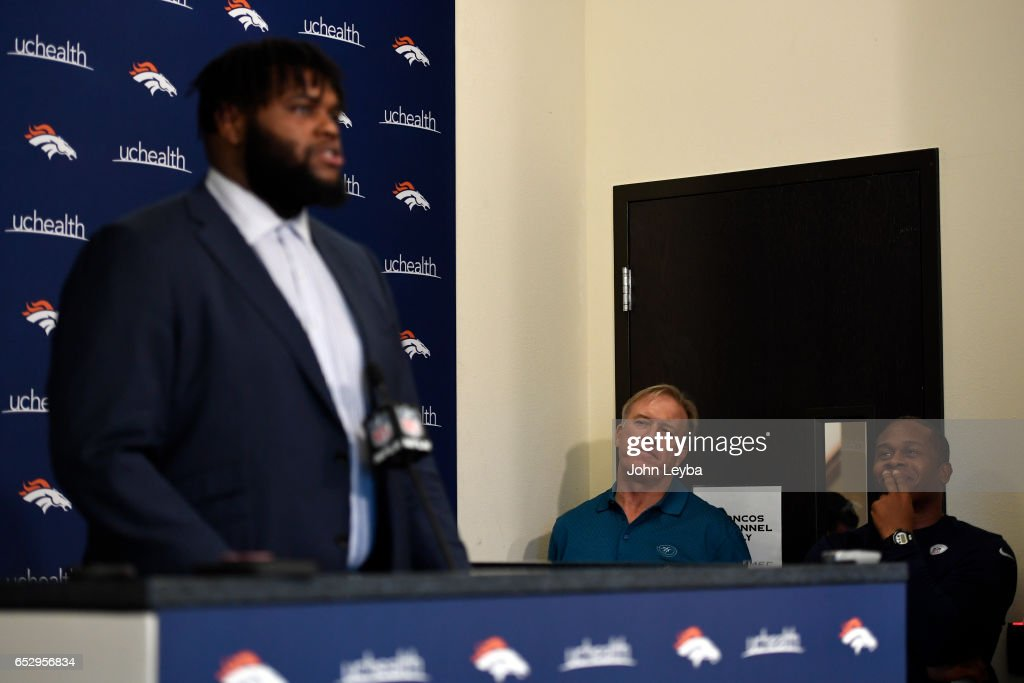 Denver Broncos head coach Vance Joseph and Denver Broncos executive vice president of football operations and general manager John Elway listen to Denver Broncos defensive lineman Zach Kerr on March 13, 2017 in Denver, Colorado at Dove Valley. Kerr addressed the media during a press conference.