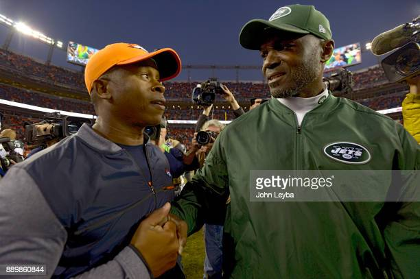 Denver Broncos head coach Vance Joseph and New York Jets head coach Todd Bowles meet at the end of the game on December 10 2017 in Denver Colorado at...