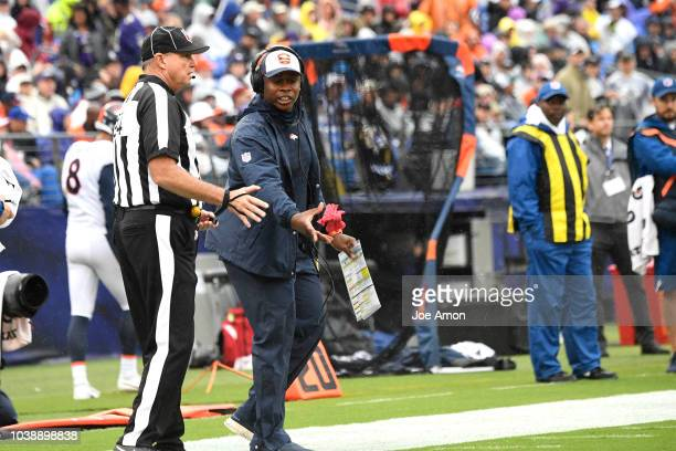 Denver Broncos head coach Vance Joseph drops the red flag for the referee with the Baltimore Ravens near the goal line at MT Bank Stadium on...