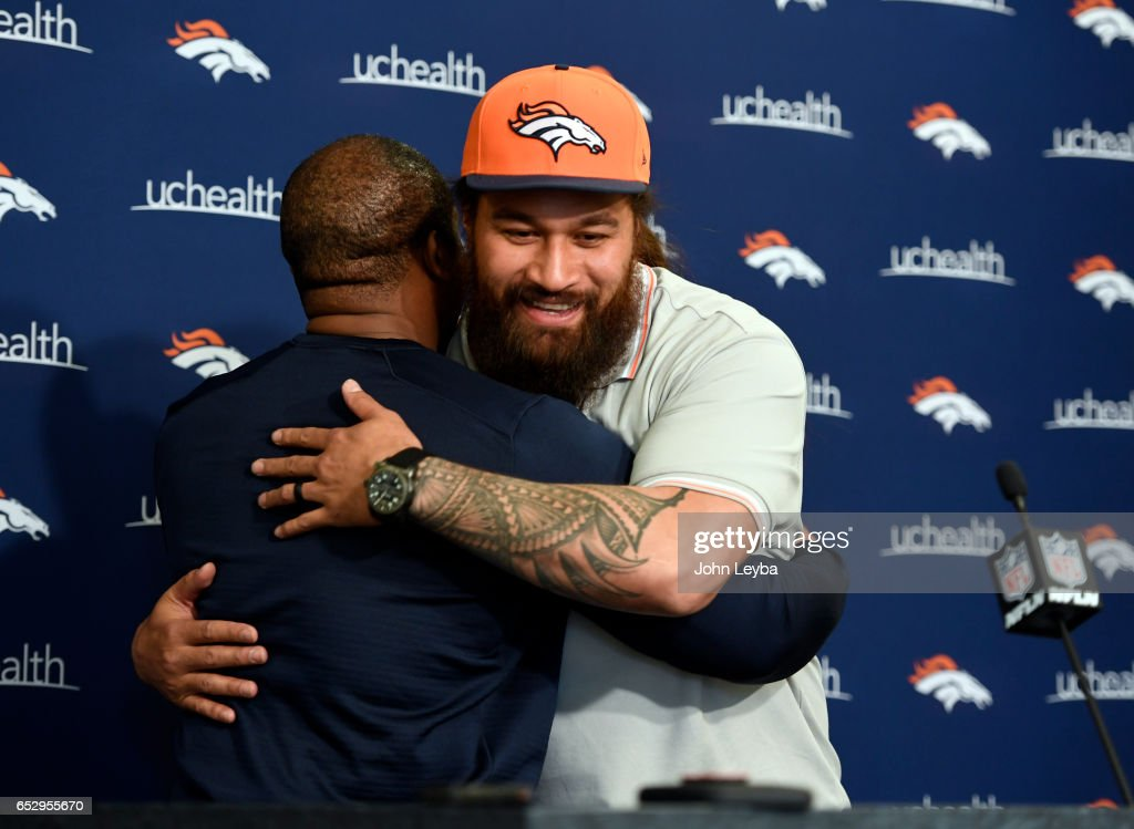 Denver Broncos head coach Vance Joseph gives a hug to Denver Broncos nose tackle Domata Peko on March 13, 2017 in Denver, Colorado at Dove Valley. Peko addressed the media during a press conference.