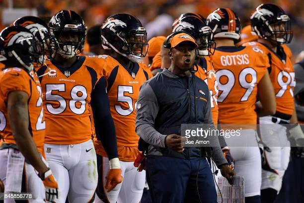 Denver Broncos head coach Vance Joseph stands with his squad as they play the Los Angeles Chargers during the third quarter on Monday September 11...