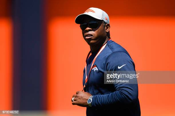 Denver Broncos head coach Vance Joseph watches workouts during the team's mandatory minicamp on Wednesday June 13 2018