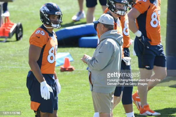 Denver Broncos head coach Vic Fangio, front right, is talking with Tight end Albert Okwuegbunam , left, during the team practice at UCHealth Training...