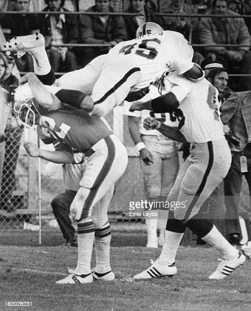 NOV 2 1975 NOV 3 1975 Denver Broncos J Phillips takes ball on kickoff and is opened by Lynch and Oaklands 46 Bankston