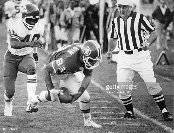 SEP 21 1975 SEP 22 1975 Denver Broncos Just like finding money on the sidewalk Denver's Jack Dolbin scoops up Otis Armstrong's fumble on the 2 and...