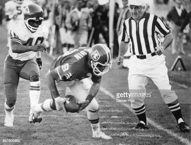Denver Broncos Just like finding money on the sidewalk Denver's Jack Dolbin scoops up Otis Armstrong's fumble on the 2 and beats Chief's Jim Marsalis...