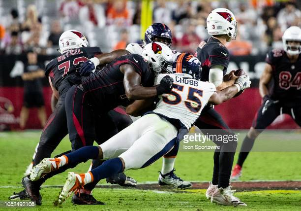 Denver Broncos linebacker Bradley Chubb strips the ball from the quarterback during NFL football game between the Arizona Cardinals and the Denver...