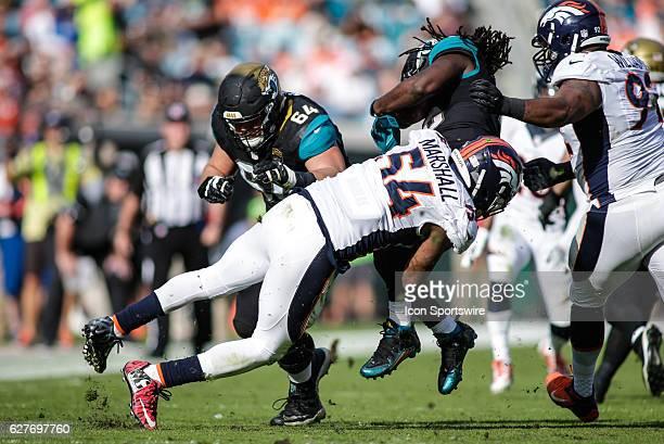 Denver Broncos Linebacker Brandon Marshall tackles Jacksonville Jaguars Running Back Denard Robinson during the NFL game between the Denver Broncos...