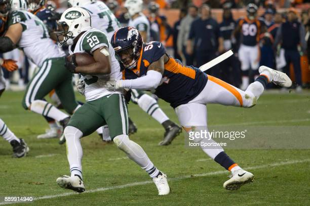 Denver Broncos linebacker Brandon Marshall tackles New York Jets running back Bilal Powell during the New York Jets vs Denver Broncos football game...