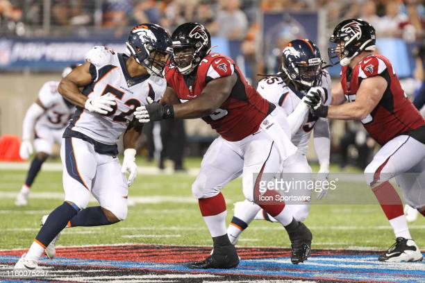Denver Broncos linebacker Justin Hollins rushes against Atlanta Falcons offensive tackle Matt Gono during the Hall of Fame Game between the Atlanta...