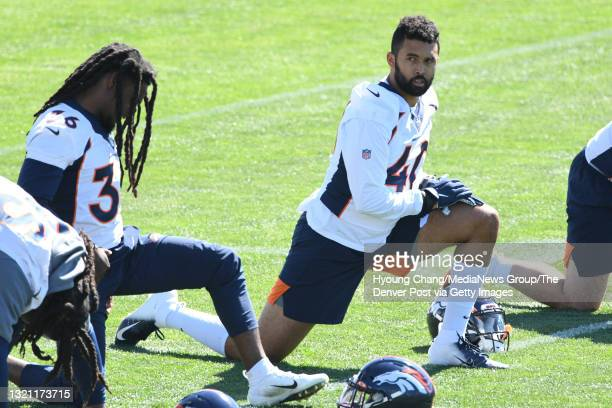 Denver Broncos linebacker Justin Strnad is stretching for the team practice at UCHealth Training Center in Englewood, Colorado on Tuesday, June 1,...