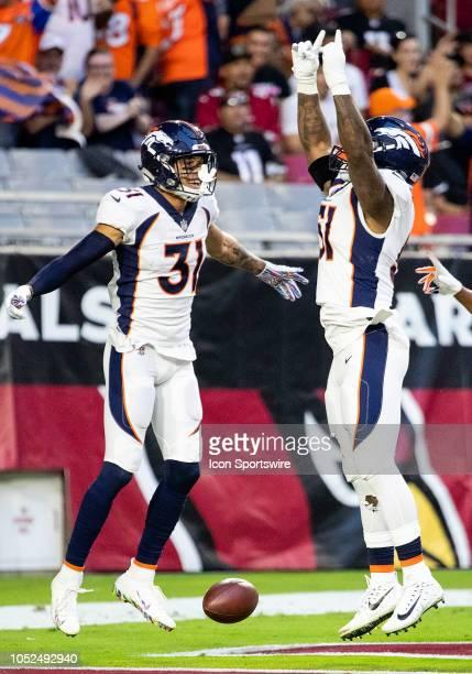 Denver Broncos linebacker Todd Davis celebrates an interception returner a touchdown during NFL football game between the Arizona Cardinals and the...