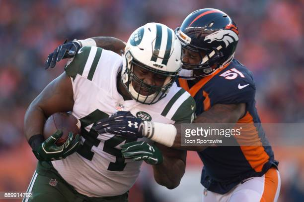 Denver Broncos linebacker Todd Davis tackles New York Jets fullback Lawrence Thomas during the New York Jets vs Denver Broncos football game at...