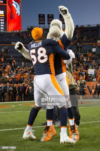 Denver Broncos linebacker Von Miller celebrates with Miles the mascot during the New York Jets vs Denver Broncos football game at Sports Authority...
