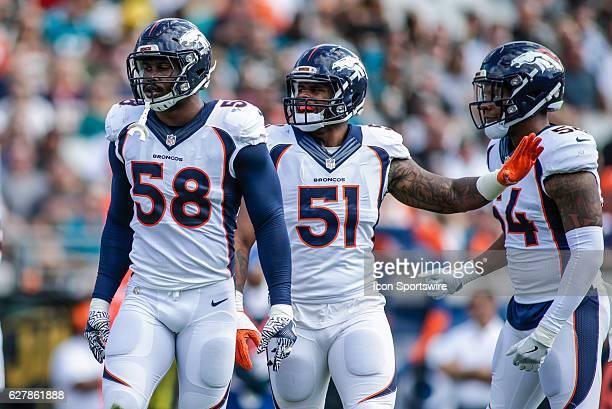 Denver Broncos Linebacker Von Miller Denver Broncos Linebacker Todd Davis and Denver Broncos Linebacker Brandon Marshall look on during the NFL game...