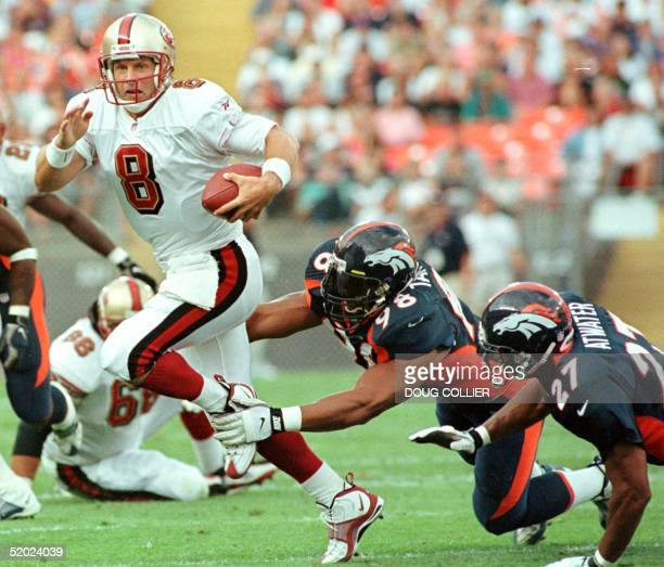Denver Broncos Maa Tanuvasa gets a hand on San Francisco 49ers quarterback Steve Young for a sack as Bronco Steve Atwater falls during first quarter...