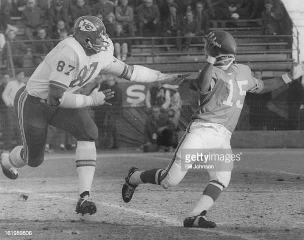 DEC 14 1968 DEC 15 1968 Denver Broncos Marlin Briscoe tries unsuccessfully to get away from Aaron Brown Denver quarterback Marlin Briscoe tries to...