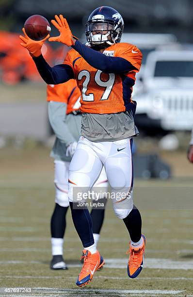 Denver Broncos Michael Huff catches a pass during practice December 18 2013 at Dove Valley