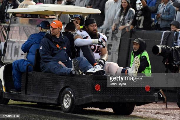 Denver Broncos nose tackle Domata Peko is carted off the field with an injury during the fourth quarter against the Oakland Raiders on November 26...