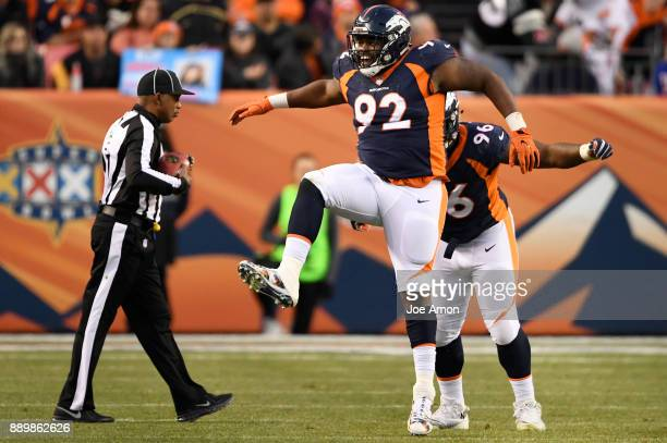 Denver Broncos nose tackle Zach Kerr and defensive end Shelby Harris celebrate stopping the New York Jets on 3rd and 3 to force a punt in the 4th...