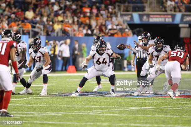 Denver Broncos offensive guard Don Barclay , offensive guard Jake Brendel , and offensive tackle Sam Jones block during the Hall of Fame Game between...
