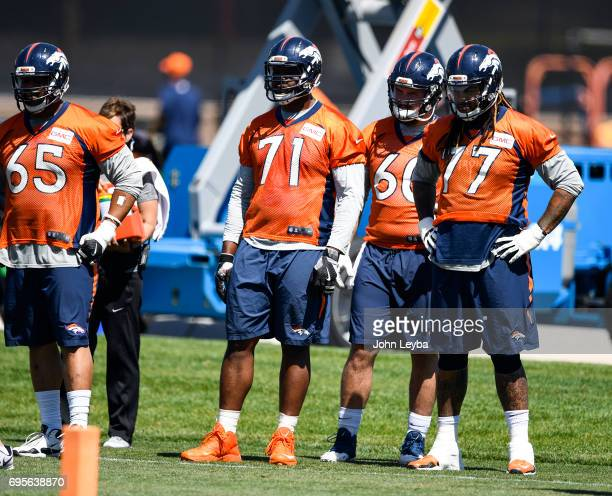 Denver Broncos offensive guard Ron Leary offensive tackle Donald Stephenson offensive guard Connor McGovern and offensive guard Billy Turner watch...