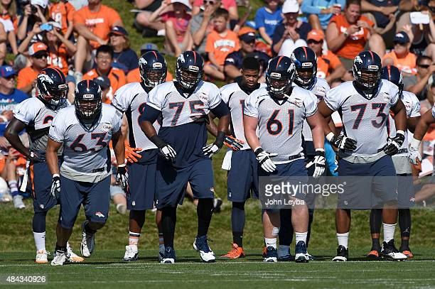 Denver Broncos offensive line during training camp August 17 2015 at Broncos headquarters