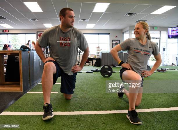 Denver Broncos offensive lineman Michael Schofield and his fiancee USA Hockey player Kendall Coyne have a laugh together during a workout at Landow...