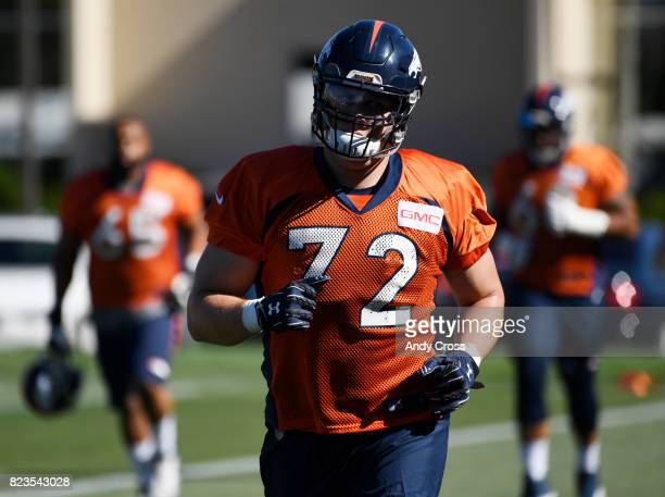 Denver Broncos offensive tackle Garett Bolles enters the practice field on the first day of training camp at Dove Valley July 26 2017
