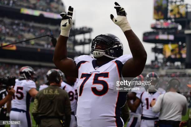 Denver Broncos offensive tackle Menelik Watson gestures during a NFL football game between the Denver Broncos and the Philadelphia Eagles on November...
