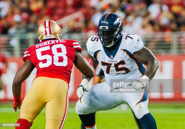 Denver Broncos offensive tackle Menelik Watson guards the right side against San Francisco 49ers defensive end Elvis Dumervil during the preseason...