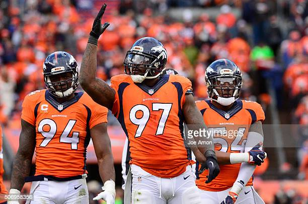 Denver Broncos outside linebacker DeMarcus Ware defensive end Malik Jackson and inside linebacker Brandon Marshall waiting on the line in the second...