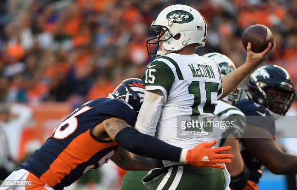 Denver Broncos outside linebacker Shane Ray puts a big hit on New York Jets quarterback Josh McCown during the third quarter on December 10 2017 in...