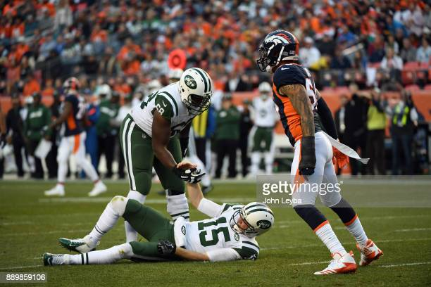 Denver Broncos outside linebacker Shane Ray puts a big hit on New York Jets quarterback Josh McCown during the third quarter as he gets helped up by...