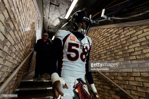Denver Broncos outside linebacker Von Miller walks down the hallway during the regular season NFL football game against the Oakland Raiders on...
