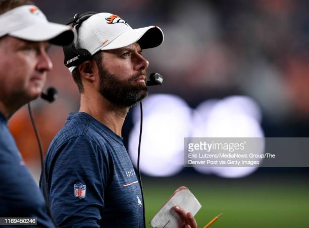 Denver Broncos outside linebackers coach Brandon Staley on the sideline during the fourth quarter of the game on Monday August 19 at Broncos Stadium...