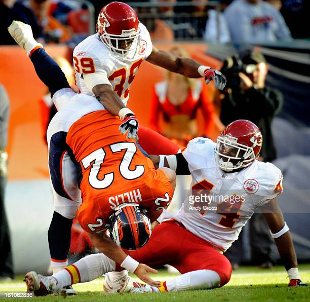 Denver Broncos' Peyton Hillis us upended by Kansas City Chiefs' Jarrad Page and Brandon Carr in the second quarter Hillis was injured on the play and...
