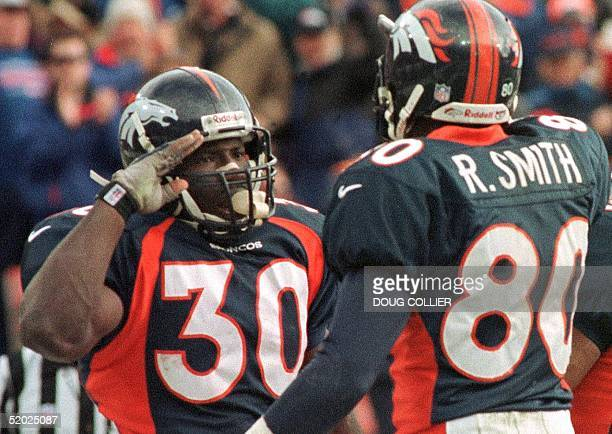Denver Broncos player Terrell Davis gives the Broncos salute to teammate Rod Smith after Davis scored his first touchdown in the first quarter of...