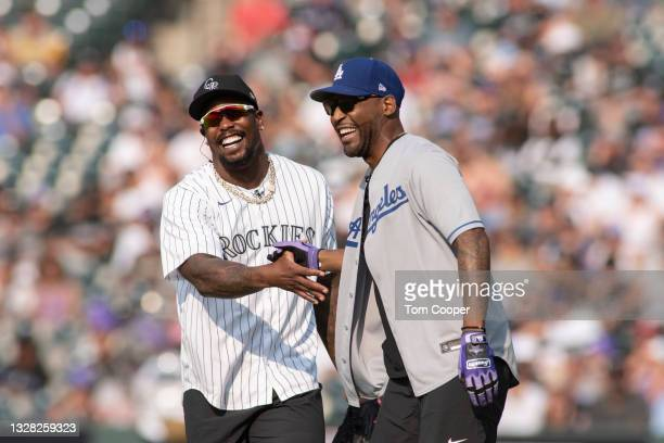 Denver Bronco's player Von Miller and TV personality Karamo Brown during the MLB All-Star Celebrity Softball Game at Coors Field on July 11, 2021 in...