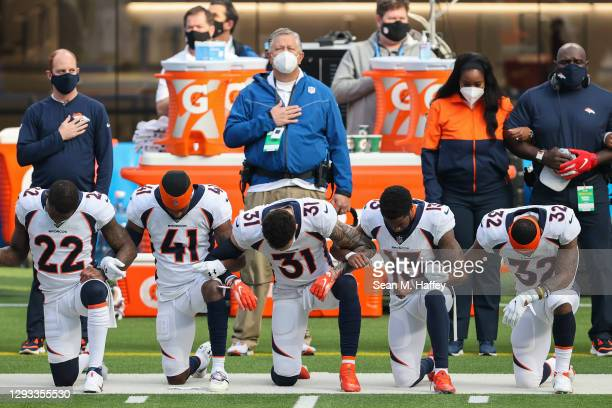Denver Broncos players kneel during the national anthem before playing against the Los Angeles Chargers at SoFi Stadium on December 27, 2020 in...
