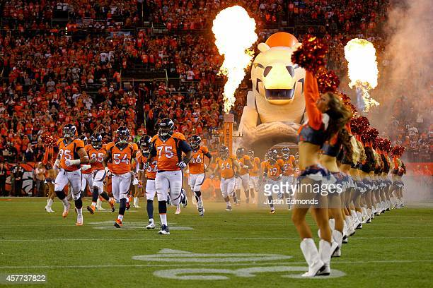 Denver Broncos players run onto the field during player introductions before a game against the San Diego Chargers at Sports Authority Field at Mile...